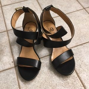 Black strappy sandals with gold heel